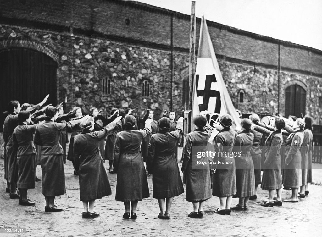 Germany, After Sixth Months Of Reich Labour Service,These Young Women Salute The German Nazi Flag During A Farewell Ceremony, In March 1939 : News Photo