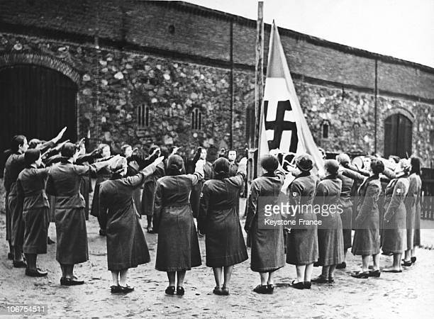 Germany After Sixth Months Of Reich Labour ServiceThese Young Women Salute The German Nazi Flag During A Farewell Ceremony In March 1939