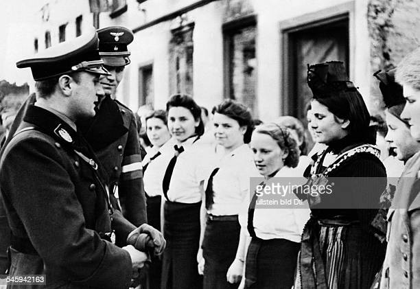 Germany Alsace Lauterburg Reich Youth Leader Artur Axmann welcoming the accepted girls of the BDM Published by 'Berliner Volkszeitung' Vintage...