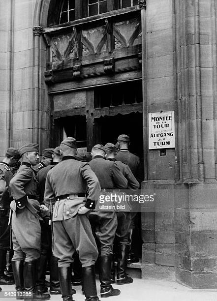 Germany AlsaceLorraine imperial territory Strasbourg German soldiers in front of the entrance of the tower of the Strasbourg Cathedral ca 1940...