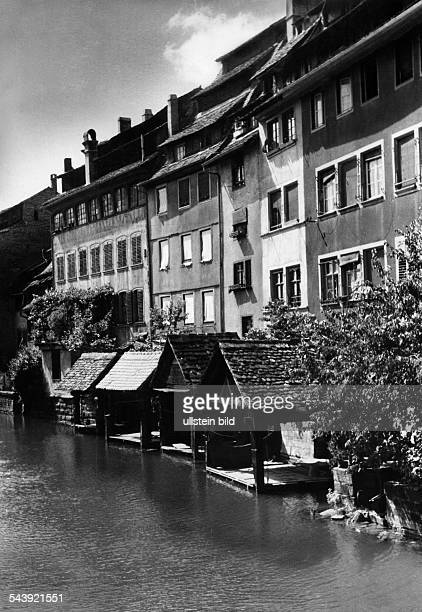 Germany AlsaceLorraine imperial territory Strasbourg View on the old houses over the river Ill ca 1940 Photographer Erich Engel Published by 'Hier...