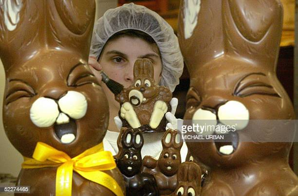 An employee of the confectionery Felicitas works on chocolate Easter bunnies at the company's production site in Hornow near Cottbus eastern Germany...
