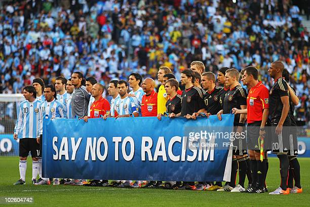 Germany and Argentina hold an antiracism banner for photographs ahead of the 2010 FIFA World Cup South Africa Quarter Final match between Argentina...