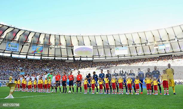 Germany and Argentina line up for the National Anthems prior to the 2014 FIFA World Cup Brazil Final match between Germany and Argentina at Maracana...