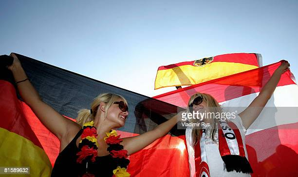 Germany and Austria football fans pose for a photo during the UEFA EURO 2008 Group B match between Austria and Germany outside the KoelnArena on June...
