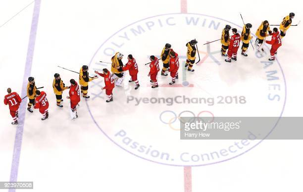 Germany and Olympic Athletes from Russia shake hands after the Men's Gold Medal Game on day sixteen of the PyeongChang 2018 Winter Olympic Games at...