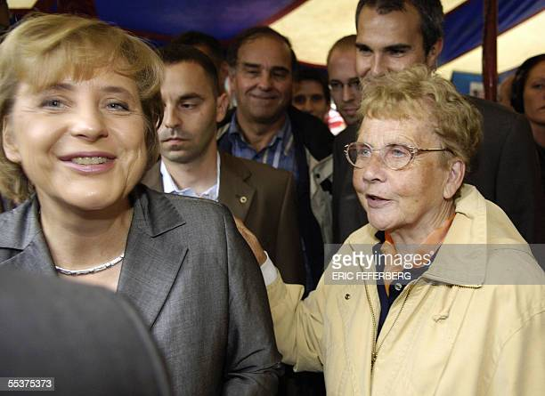 Angela Merkel leader of the Christian Democratic Union party and candidate for chancellor of the conservative opposition listens her mother Herlind...