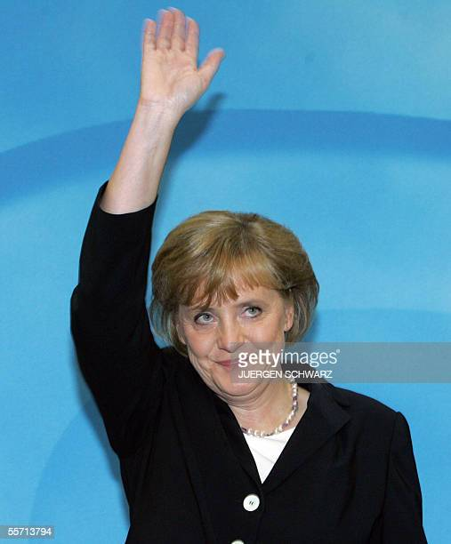 Angela Merkel leader of the Christian Democratic Union party and top candidate for Chancellor of the conservative opposition waves to her supporters...
