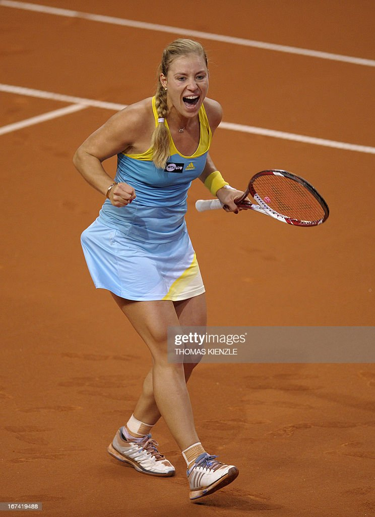 Germany Angelique Kerber reacts as she wins 6-0, 6-4 against Russia's Anastasia Pavlyuchenkova in their match at the WTA Porsche Tennis Grand Prix in Stuttgart, southwestern Germany, on April 25, 2013.