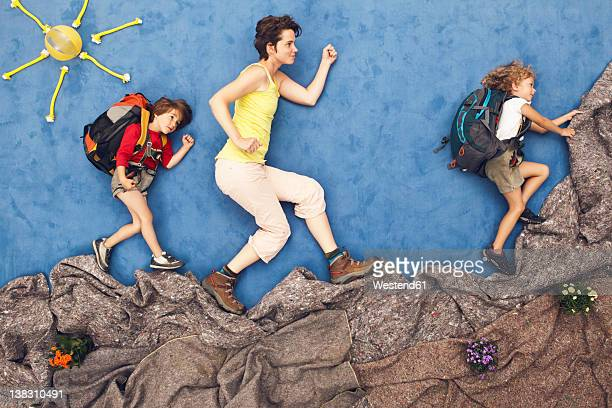 Germany, Artificial scene of family mountaineering
