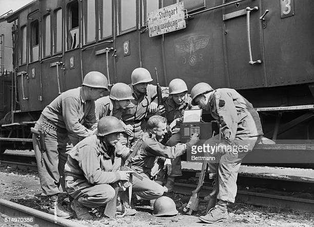 As GI's Heard Tragic Newsthese men of the US Seventh Army were on guard at a German railway station recently captured when they received news of the...