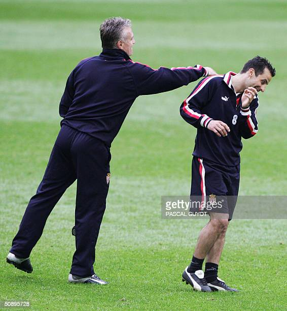 AS Monaco monaco trainer Didier Deschamps jokes with captain Ludovic Giuly 25 May 2004 in the Arena AufSchalke stadium in the western town of...