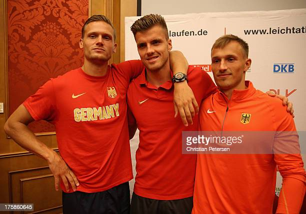 Germany athletes Pascal Behrenbruch Rico Freimuth and Michael Schrader pose together following a press conference ahead of the 14th IAAF World...
