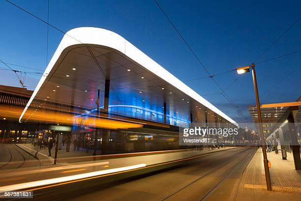 Germany, Augsburg, tram stop at Koenigsplatz in the evening