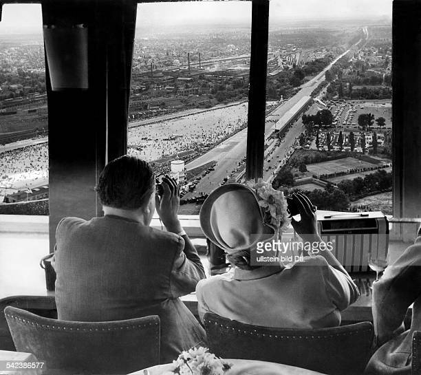 Germany, Avus in Berlin: couple watching the car racing from the restaurant in the Funkturm- 1951photo by Joachim Diederichsphoto-mounting