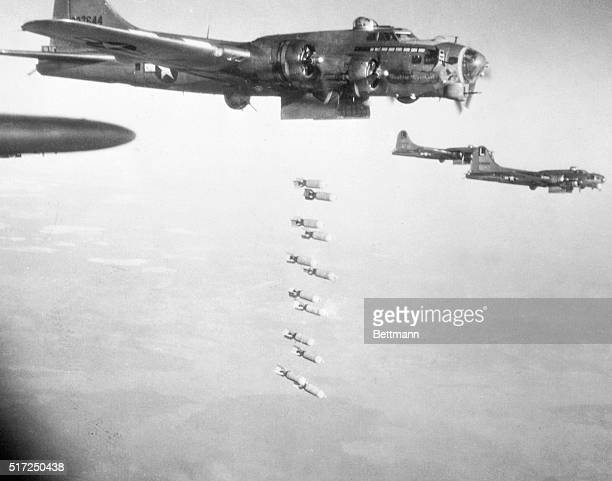 B17 Flying Fortresses of the U S Eighth Air Force drop their holiday greetings from open bombbay doors high over Germany on December 24th This was...
