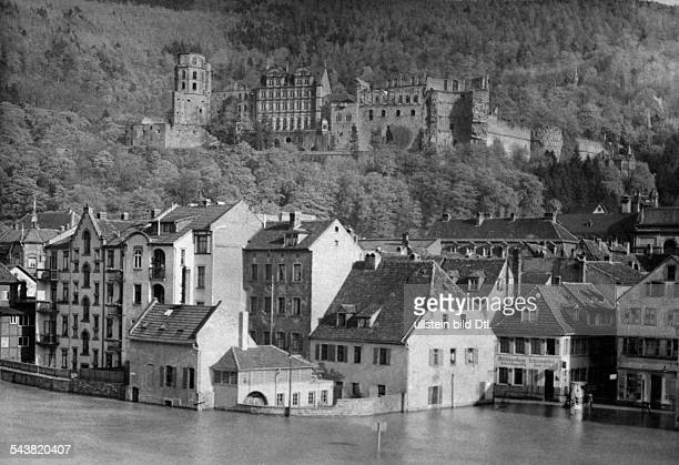 Germany Baden Heidelberg highwater from thr river Neckar parts of the old city are floode in the background Heidelberg Palacepublished in Zeitbild...
