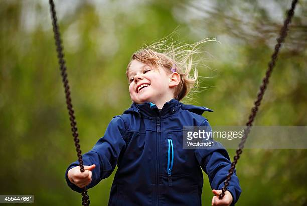 Germany, Baden Wuerttemberg, Girl swinging on swing