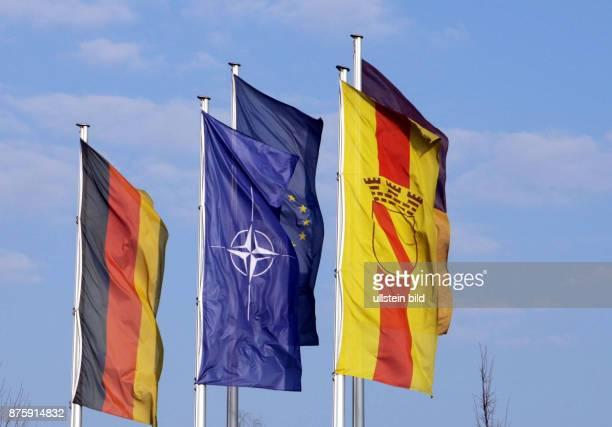 Germany BadenWuerttemberg BadenBaden Nato summit national flag of germany flag of the nato and flag of BadenBaden city