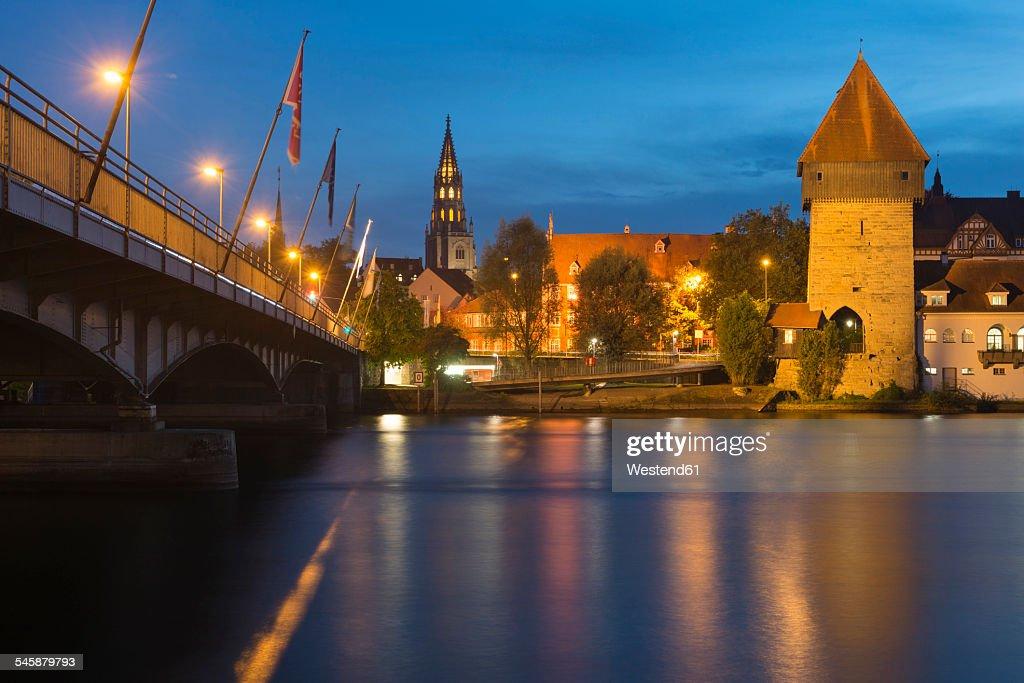 Germany, Baden-Wuerttemberg, Constance, Rhine bridge, Rheintorturm and minster at night : Stock Photo