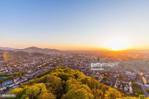 germany, baden-wuerttemberg, freiburg, city view at sunset - baden württemberg stock photos and pictures