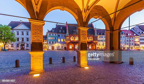 Germany, Baden-Wuerttemberg, Freiburg, Old town, Munster Square, historical department store and restaurants, blue hour