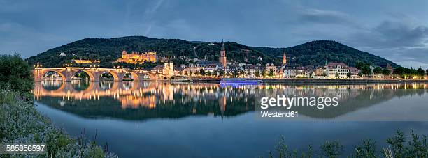 Germany, Baden-Wuerttemberg, Heidelberg, Heidelberg Castle and Neckar river in the evening