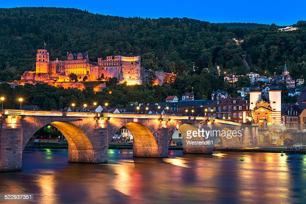 germany, baden-wuerttemberg, heidelberg, view to old town, old bridge and heidelberg castle in the evening - heidelberg germany stock pictures, royalty-free photos & images