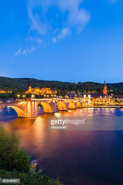 Germany, Baden-Wuerttemberg, Heidelberg, View to Old town, Old bridge, Church of the Holy Spirit and Heidelberg Castle in the evening