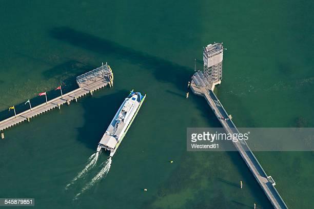 Germany, Baden-Wuerttemberg, Lake Constance, Friedrichshafen, aerial view of catamaran at harbor entrance