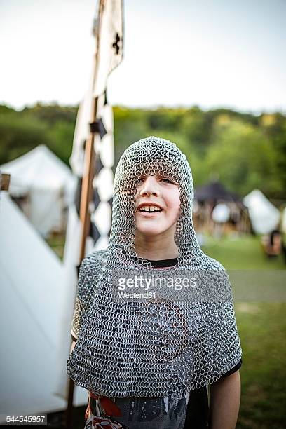 Germany, Baden-Wuerttemberg, Moensheim, boy in chain mail on medieval fair