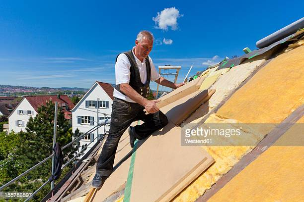 germany, baden-wuerttemberg, stuttgart, mature man placing insulation - isoliert stock-fotos und bilder