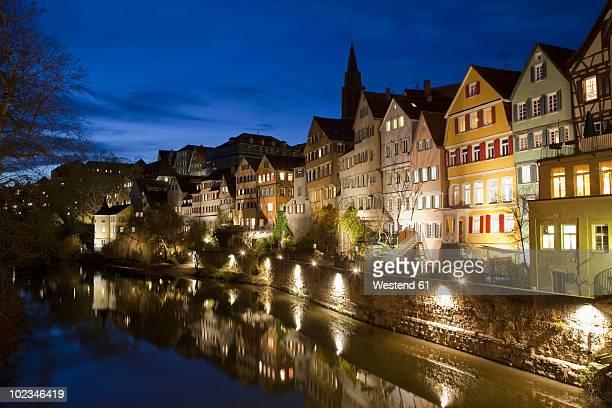 Germany, Baden-Wuerttemberg, Tuebingen, Buildings along Neckar river at night