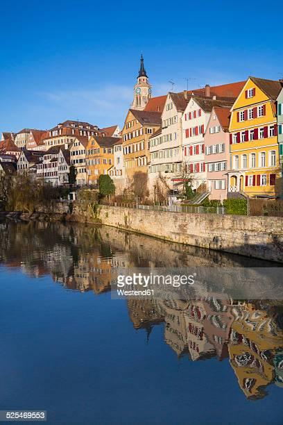 Germany, Baden-Wuerttemberg, Tuebingen, Row of houses, Neckar river, Collegiate church in the background