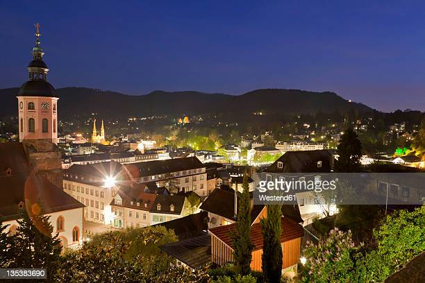 Germany, Baden-Wurttemberg, Baden-Baden, Black Forest, View of collegiate church with cityscape at night