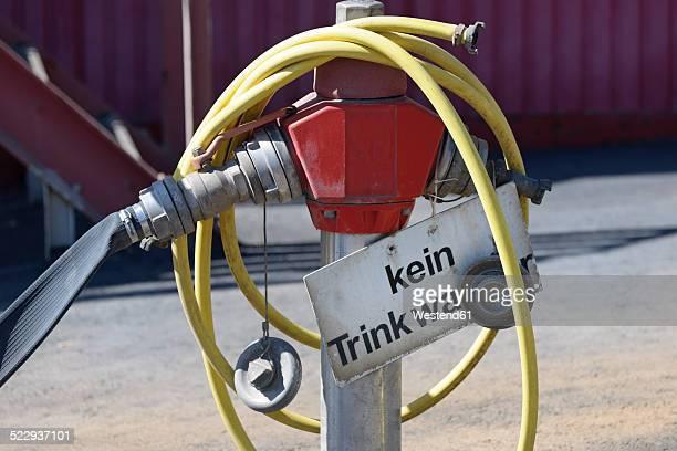 Germany, Baden-Wurttemberg, incinerator TREA Breisgau, hydrant with water hose