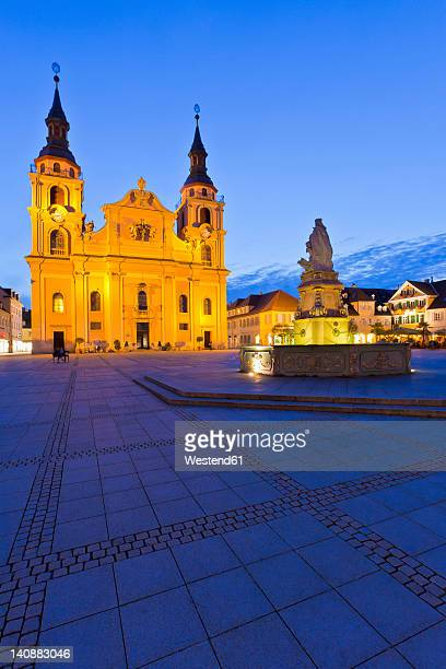 Germany, Baden-Wurttemberg, Ludwigsburg, View of protestant town church with fountain at night