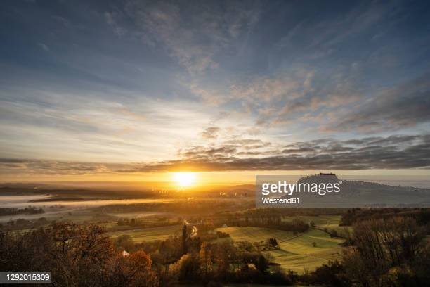 germany, baden-wurttemberg, singen, foggy sunrise withhohentwiel mountain in background - baden württemberg stock pictures, royalty-free photos & images