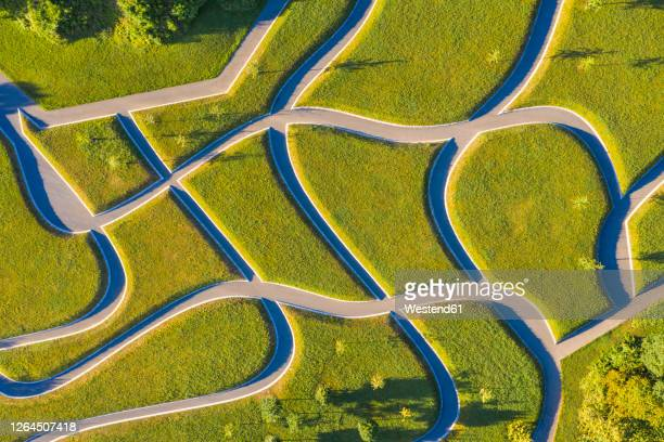 germany, baden-wurttemberg, stuttgart, aerial view on intersecting footpaths in killesbergpark - baden württemberg stock-fotos und bilder