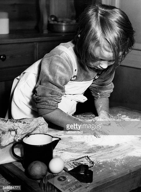 Germany baking cakes young girl rolling pastry in the fifties