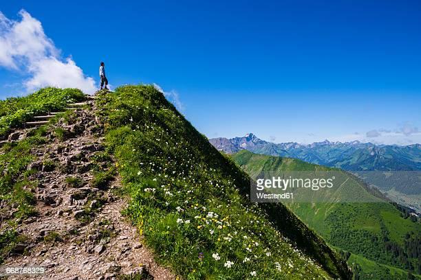 Germany, Bavaria, Allgaeu Alps, Fellhorn, hiking trail and female hiker