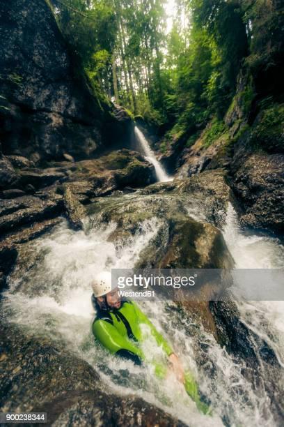 Germany, Bavaria, Allgaeu, man canyoning in Ostertal