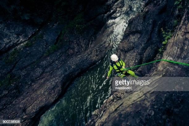Germany, Bavaria, Allgaeu, young man canyoning in Ostertal