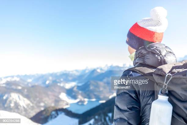 Germany, Bavaria, Alps, hiker with backpack at Lake Walchen