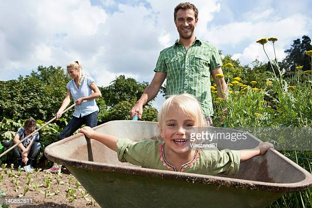 Germany, Bavaria, Altenthann, Family gardening together in garden