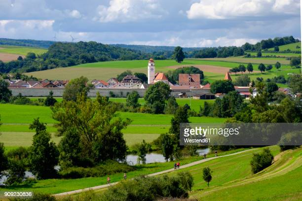 germany, bavaria, altmuehl valley, dollnstein, bicycle lane at altmuehl river - spire stock pictures, royalty-free photos & images