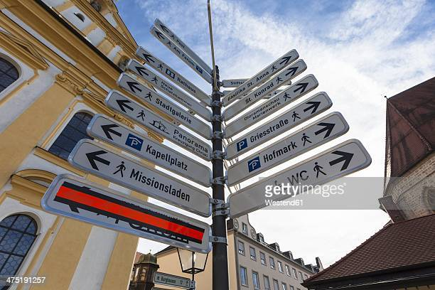 germany, bavaria, altoetting, kapellplatz, direction signs of places of interest - altötting stock photos and pictures