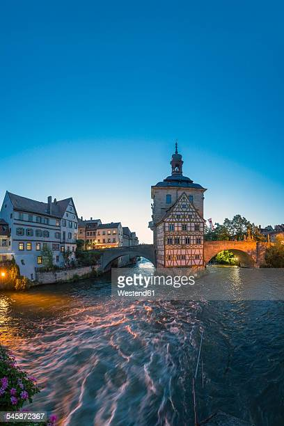 Germany, Bavaria, Bamberg, view to old town hall and River Regnitz at twilight