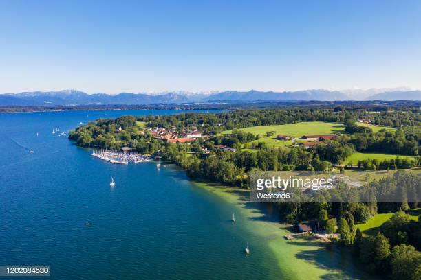 germany, bavaria, bernried am starnberger see, aerial view of harbor on shore of lake starnberg with mountains in distant background - bavaria stock pictures, royalty-free photos & images