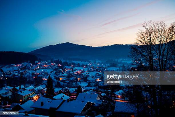 Germany, Bavaria, Bodenmais, village in winter, blue hour